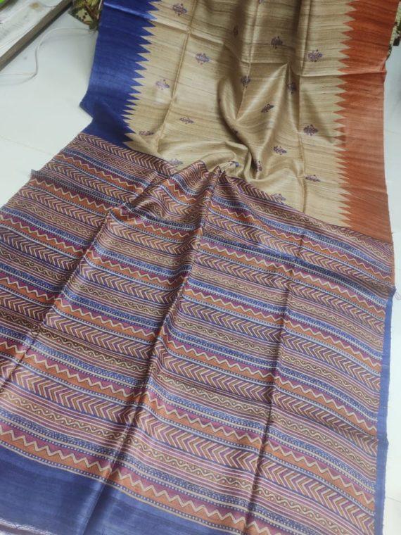 Creamish-Tussar-Silk-Saree-with-Orange-&-Blue-Border