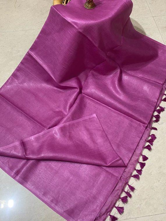 Dark pink plain linen saree with no zari border