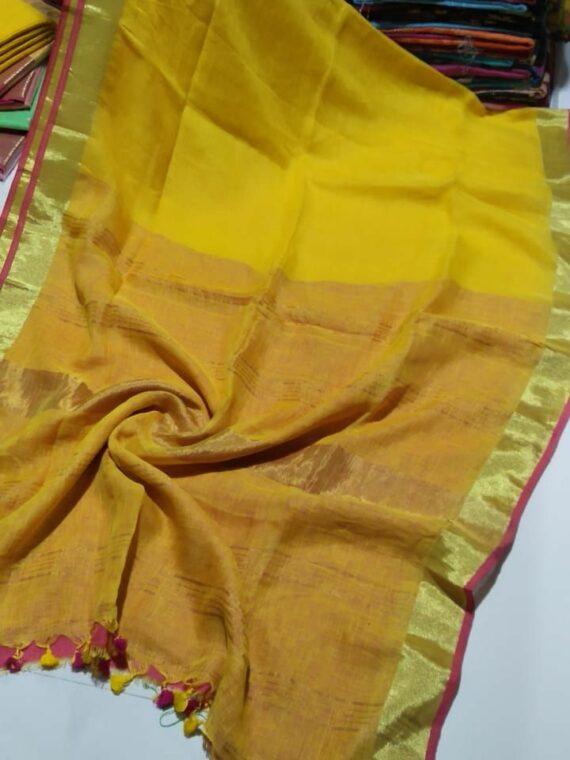 Turmeric Yellow Plain Linen Handwoven Saree With Contrast Pink Blouse